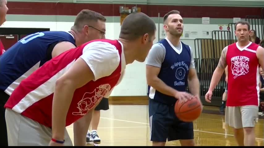 Police and firefighters face off at charity basketball game_26656657