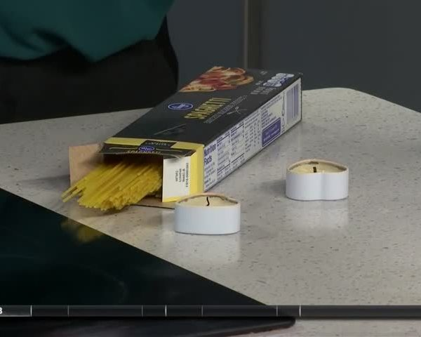 Life Hacks: Using a pasta noodle to light a candle