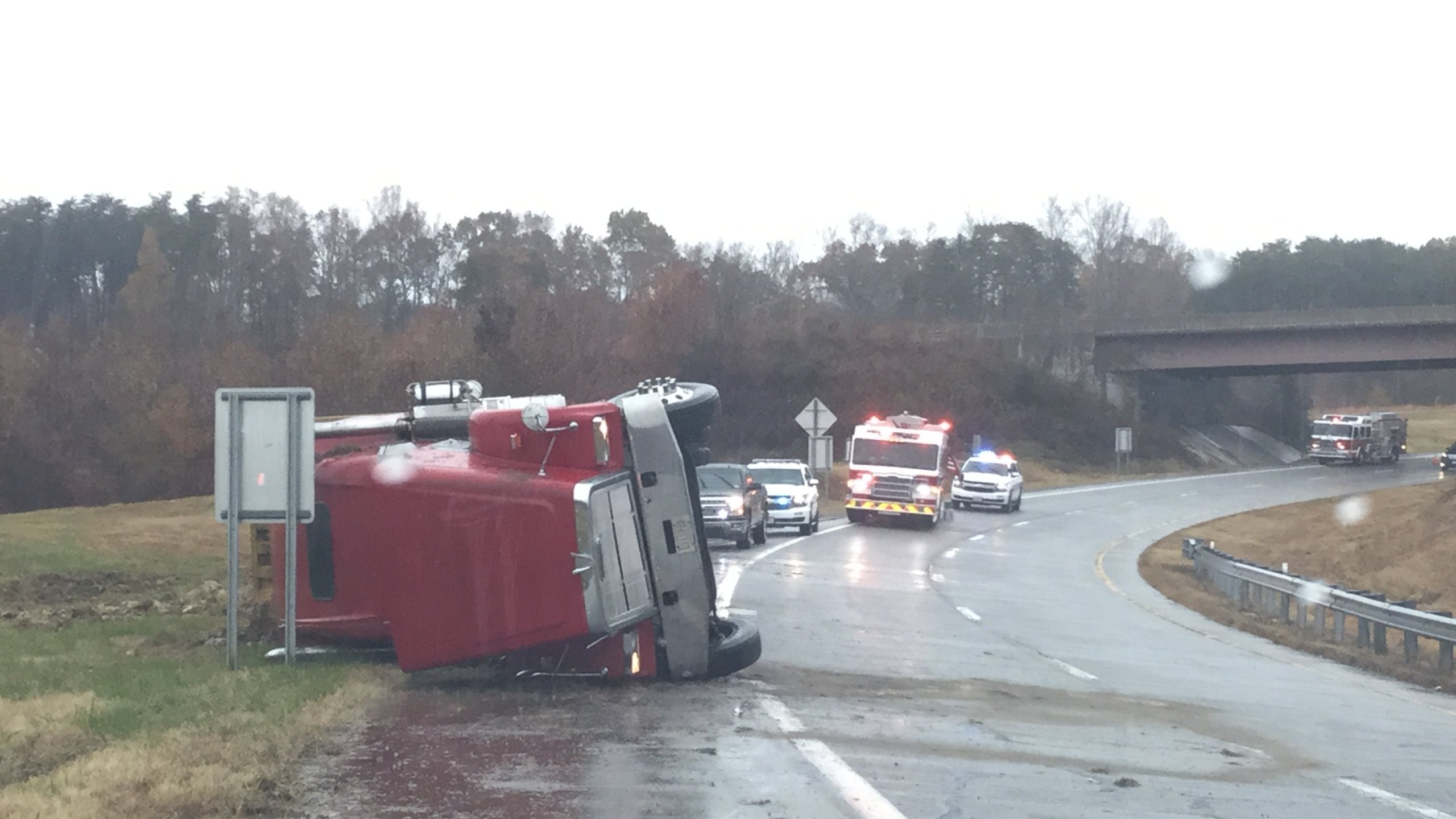 This tractor-trailer overturned on the off ramp of the Danville Expressway headed toward Greensboro, North Carolina. (Photo: Courtesy Danville Fire Department)