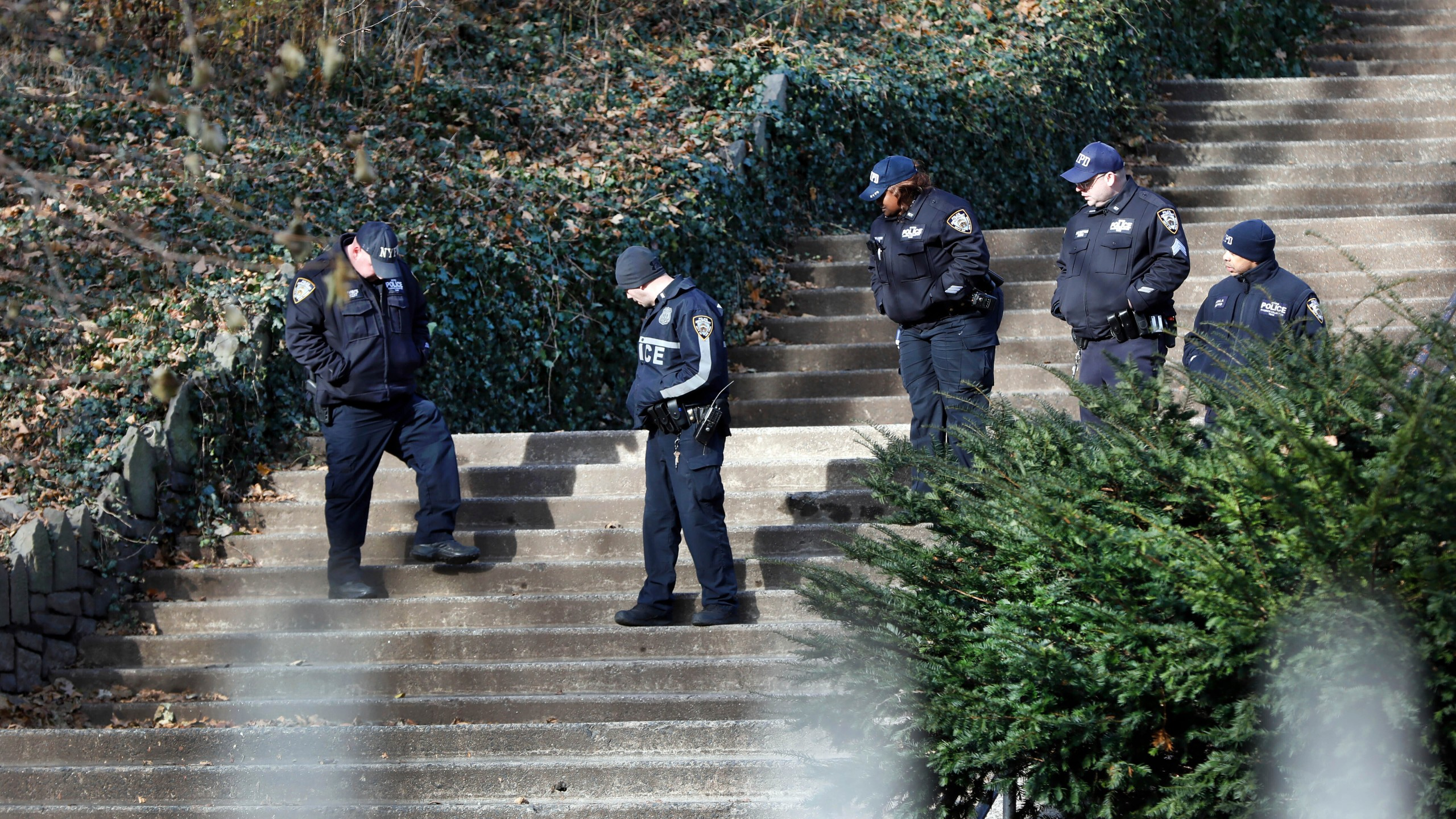 Law enforcement officers search Morningside Park along Manhattan's Upper West Side, Thursday, Dec. 12, 2019, in New York. An 18-year-old Barnard College freshman, identified as Tessa Majors, has been fatally stabbed during an armed robbery in the park, sending shock waves through the college and wider Columbia University community. (AP Photo/Richard Drew)