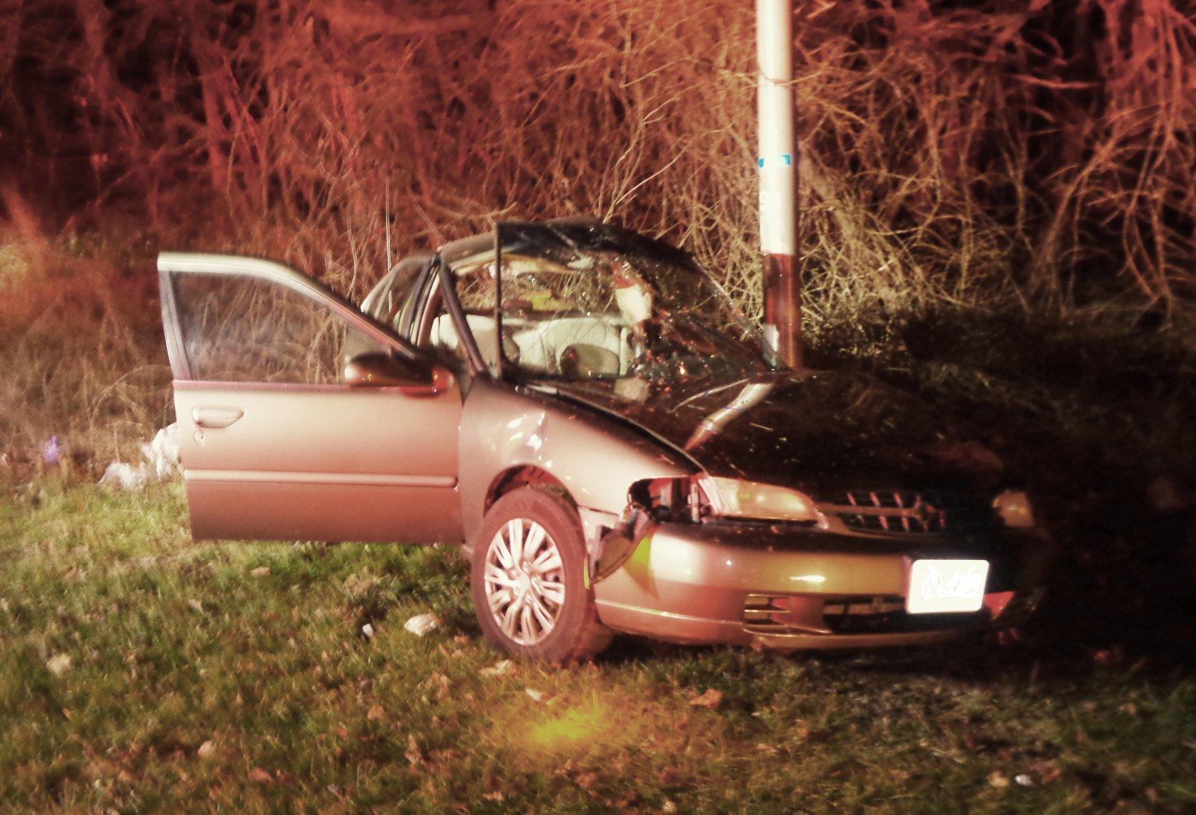 At least three people were seriously injured in a single-vehicle crash in Bedford last night. (PHOTO: Courtesy Bedford Fire Department)