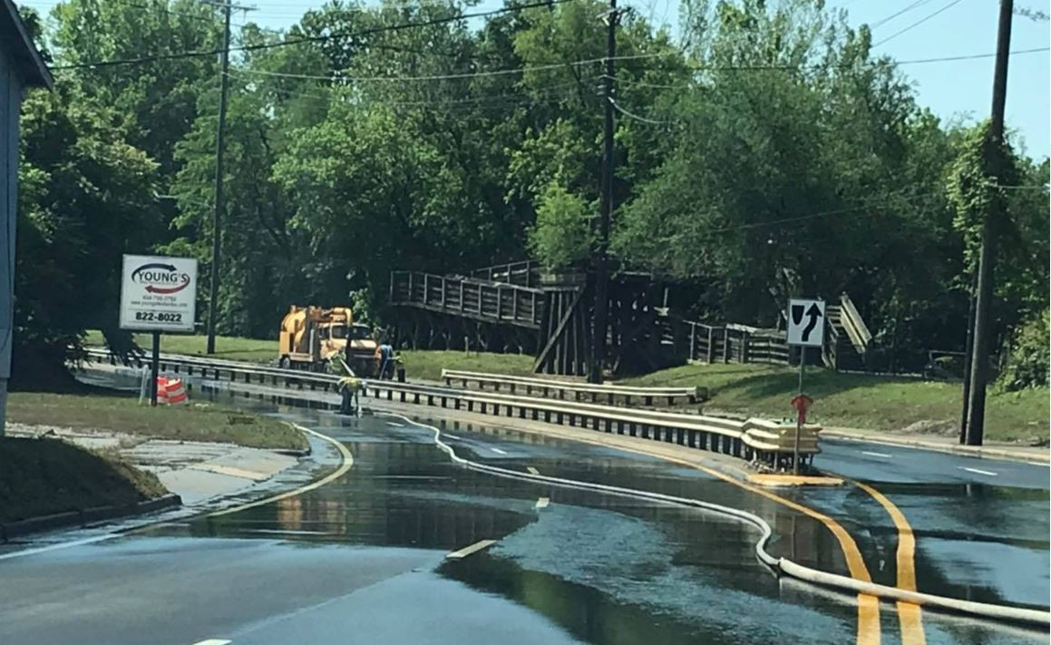 Crews from Danville Public Works clear water off River Street and other roads following this week's flooding. (Photo: Courtesy Danville Fire Department)