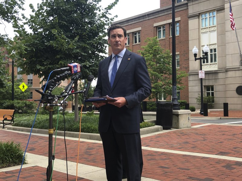 US Attorney for the Eastern District of Virginia, G. Zachary Terwilliger speaks on an MS-13 sex trafficking case at a press conference Wednesday, Aug. 5, 2020 outside the federal courthouse in Alexandria, Virginia. (AP Photo/Matthew Barakat)