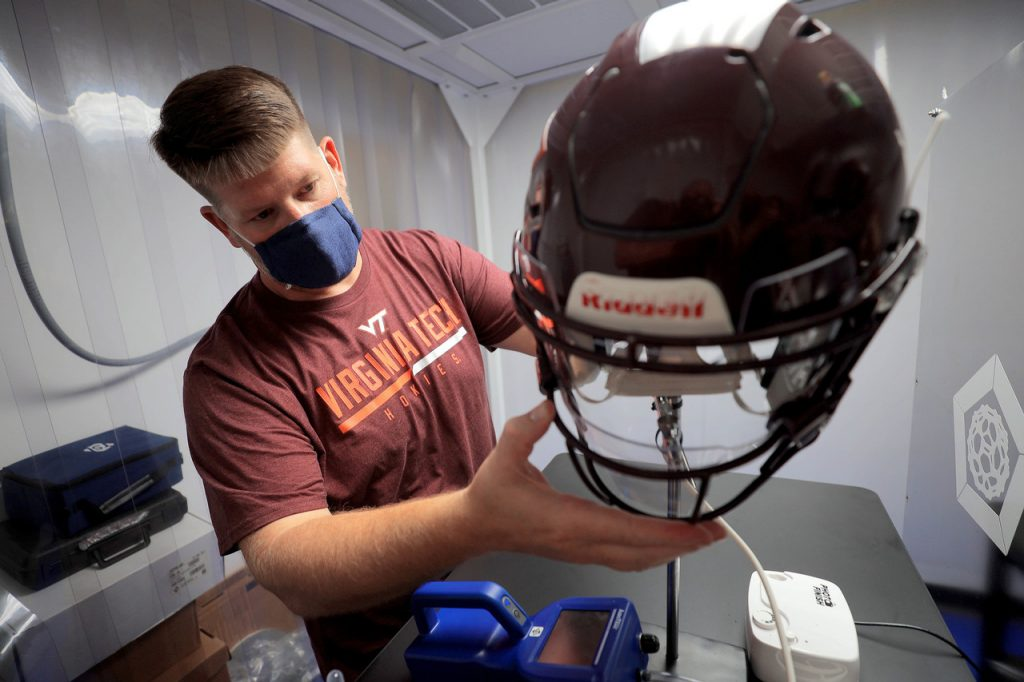 Virginia Tech researchers and designers working with new football helmets to slow the spread of COVID-19. (Photo: Courtesy Virginia Tech)